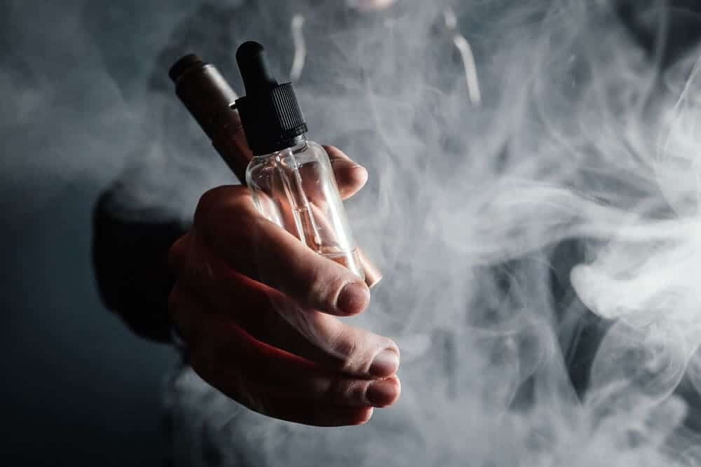 bottle of e-juice in the hand of a vaper