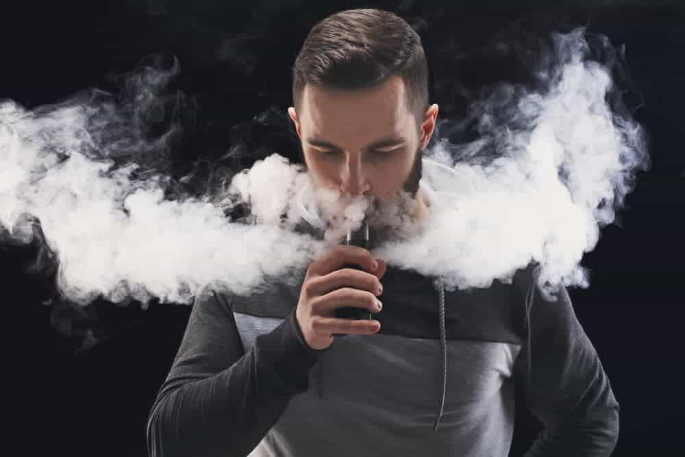 guy doing vape tricks