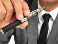 guy vaping a vape with a clearomizer image