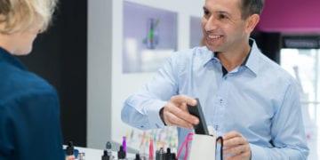 vape shop guy working