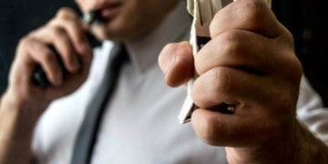 guy destroying a pack of cigarettes