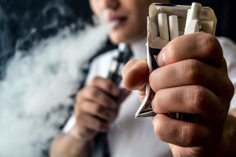 vaper crushes cigarette pack and vaping