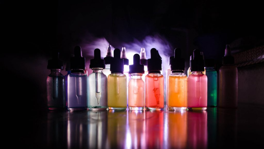 colored vape juice bottles image