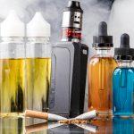 vape box mod and five bottle of e-liquid image