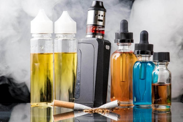 vape box mod and five bottle of e-liquid image