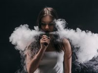 cloud chasing girl doing vape tricks image