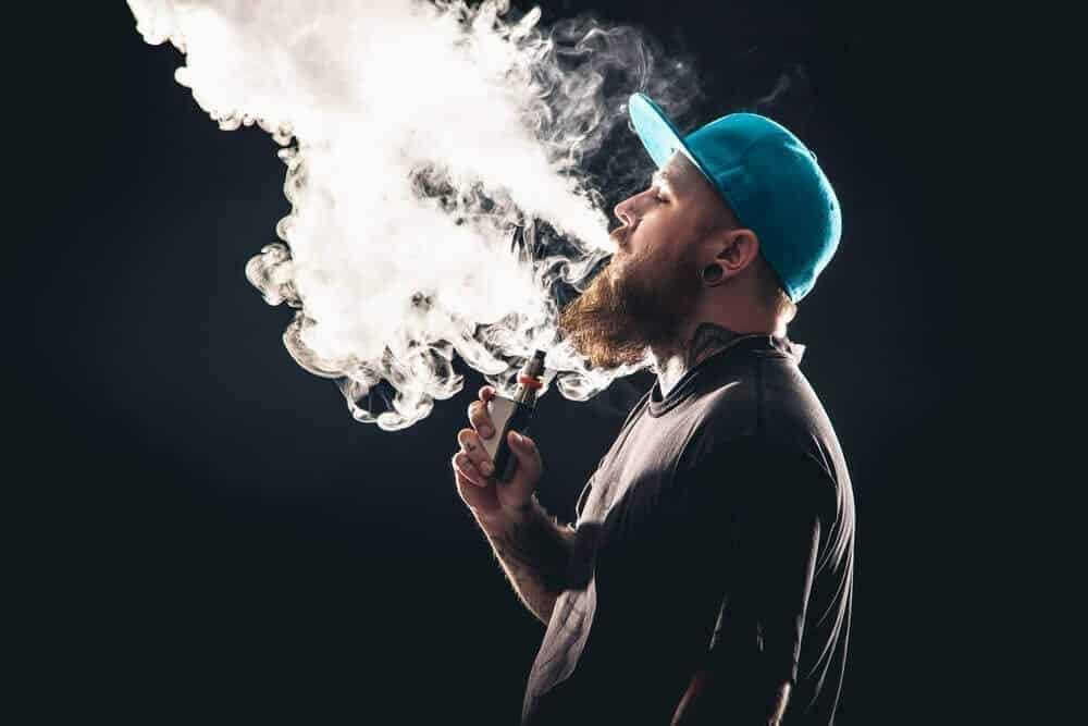 cloud chasing guy in the green cap vaping image