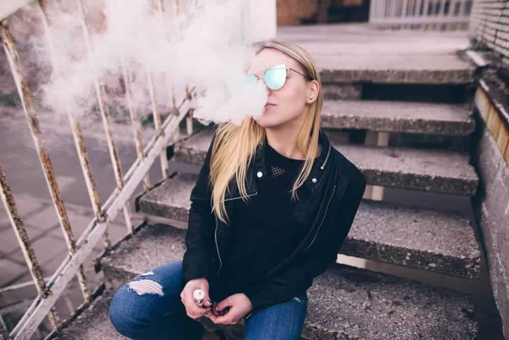 girl vaping on stairs image
