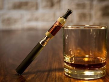vaping alcohol glass and vape image